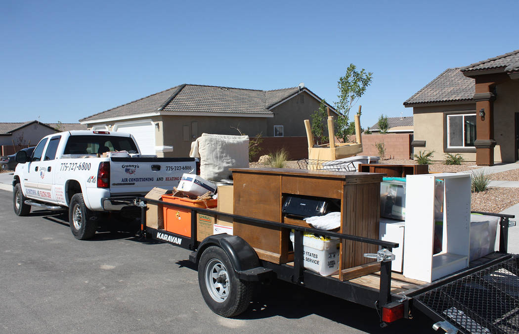 Robin Hebrock/Pahrump Valley Times A trailer loaded with home items and personal effects sits i ...