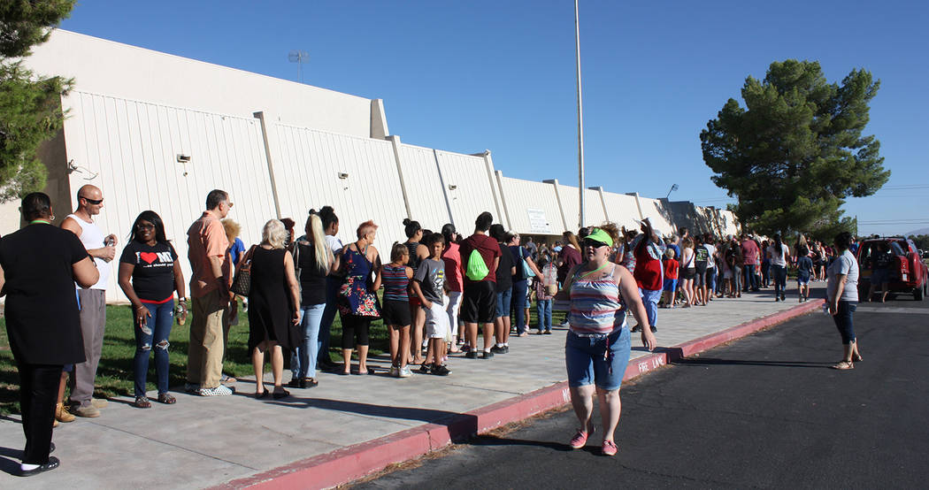 Robin Hebrock/Pahrump Valley Times A long line of Back to School Health Fair attendees is shown ...