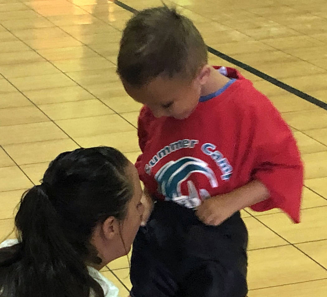 Tom Rysinski/Pahrump Valley Times A young participant gets a little help making sure his oversi ...