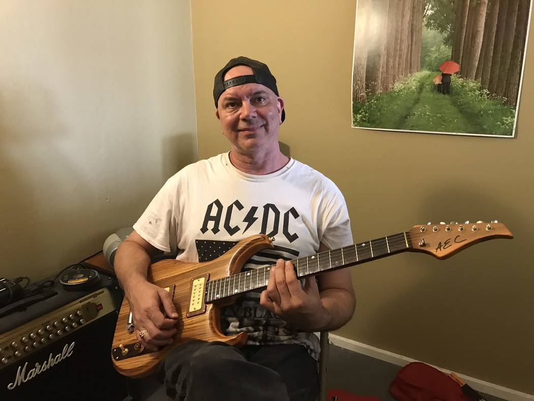Jeffrey Meehan/Pahrump Valley Times Gary Fox, owner of Foxter Music in Pahrump, sits with his g ...