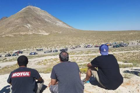 David Jacobs/Pahrump Valley Times Fans gather to watch as racers at the staging area of the sta ...