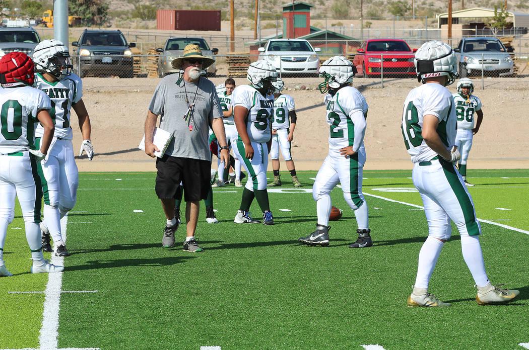 Tom Rysinski/Pahrump Valley Times Beatty High School football coach Leo Verzilli talks to his t ...