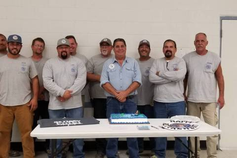 Special to the Pahrump Valley Times Matt Luis, fourth from right, stands for a group photo with ...