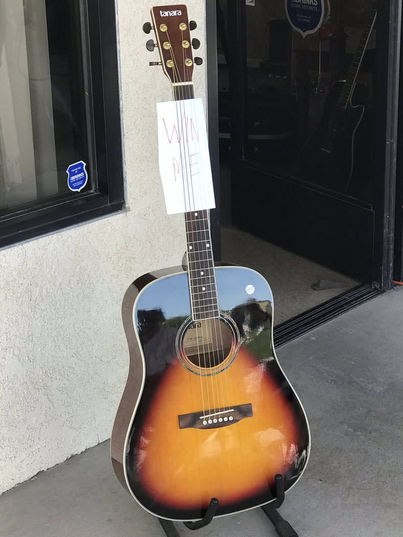 Jeffrey Meehan/Pahrump Valley Times Foxter Music raffled off an acoustic guitar in celebration ...