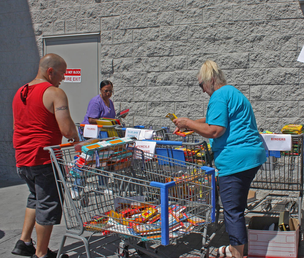 Robin Hebrock/Pahrump Valley Times Volunteers are shown sorting the many donations of school su ...