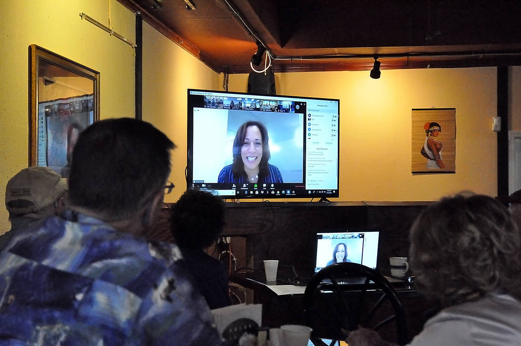 Horace Langford Jr./Pahrump Valley Times People watch Kamala Harris in a live telecast at K7 B ...