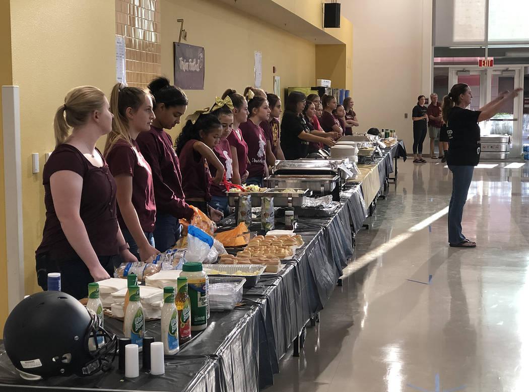 Tom Rysinski/Pahrump Valley Times Pahrump Valley High School cheerleaders stand ready to dish o ...