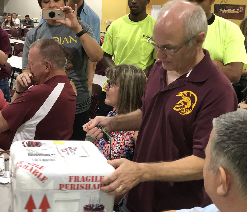 """Tom Rysinski/Pahrump Valley Times Rick Marshall ponders the best way to open his $1,600 """"Reese' ..."""