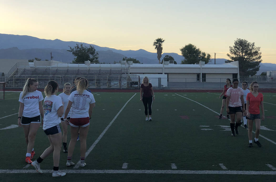 Tom Rysinski/Pahrump Valley Times Girls soccer coach Julie Carrington runs a drill before the s ...