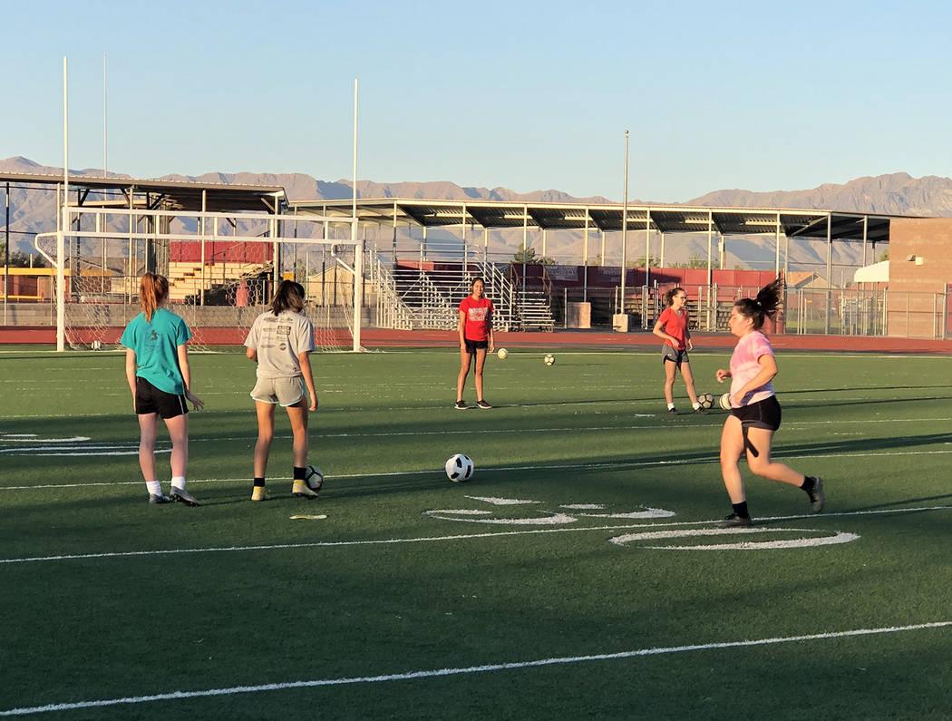 Tom Rysinski/Pahrump Valley Times Pahrump Valley High School girls soccer players at morning pr ...