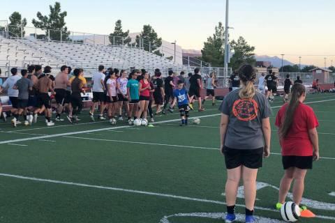 Tom Rysinski/Pahrump Valley Times Pahrump Valley High School girls soccer players begin a drill ...