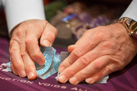 A dealer shuffles cards at the blackjack table at SLS Las Vegas on Thursday, May, 30, 2019, in ...