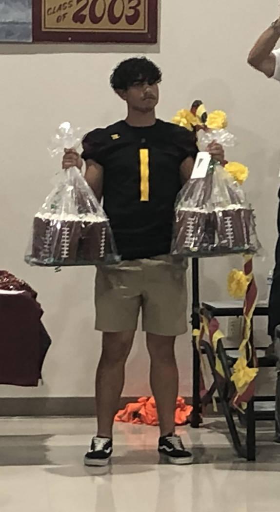 Tom Rysinski/Pahrump Valley Times Pahrump Valley junior Jalen Denton displays twin auction item ...
