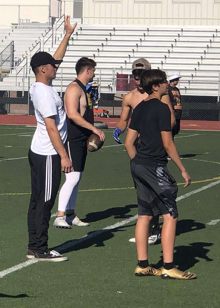 Tom Rysinski/Pahrump Valley Times Former Pahrump Valley High School quarterback AJ Segura, left ...