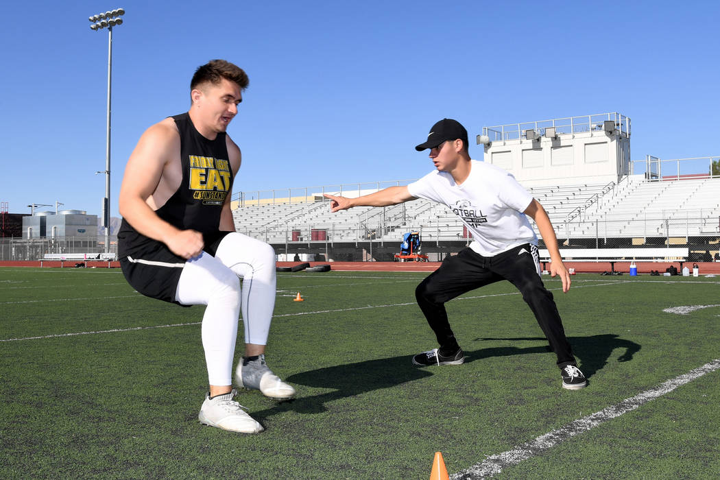 Peter Davis/Special to the Pahrump Valley Times TJ Milk, left, Pahrump Valley Class of 2016, wo ...