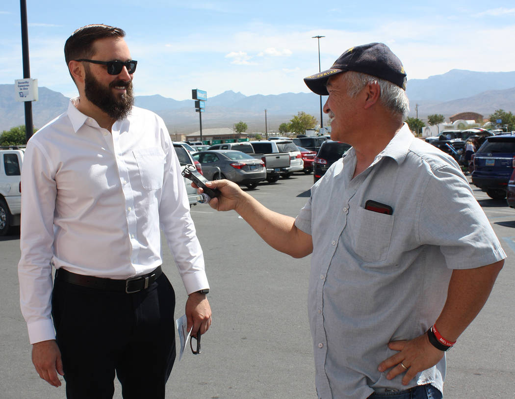 Robin Hebrock/Pahrump Valley Times Valley Electric Association staff member Vern Hee speaks wit ...