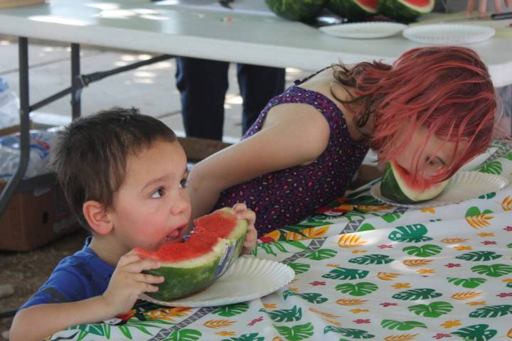 Robin Hebrock/Pahrump Valley Times Youngsters are pictured devouring cold watermelon during the ...