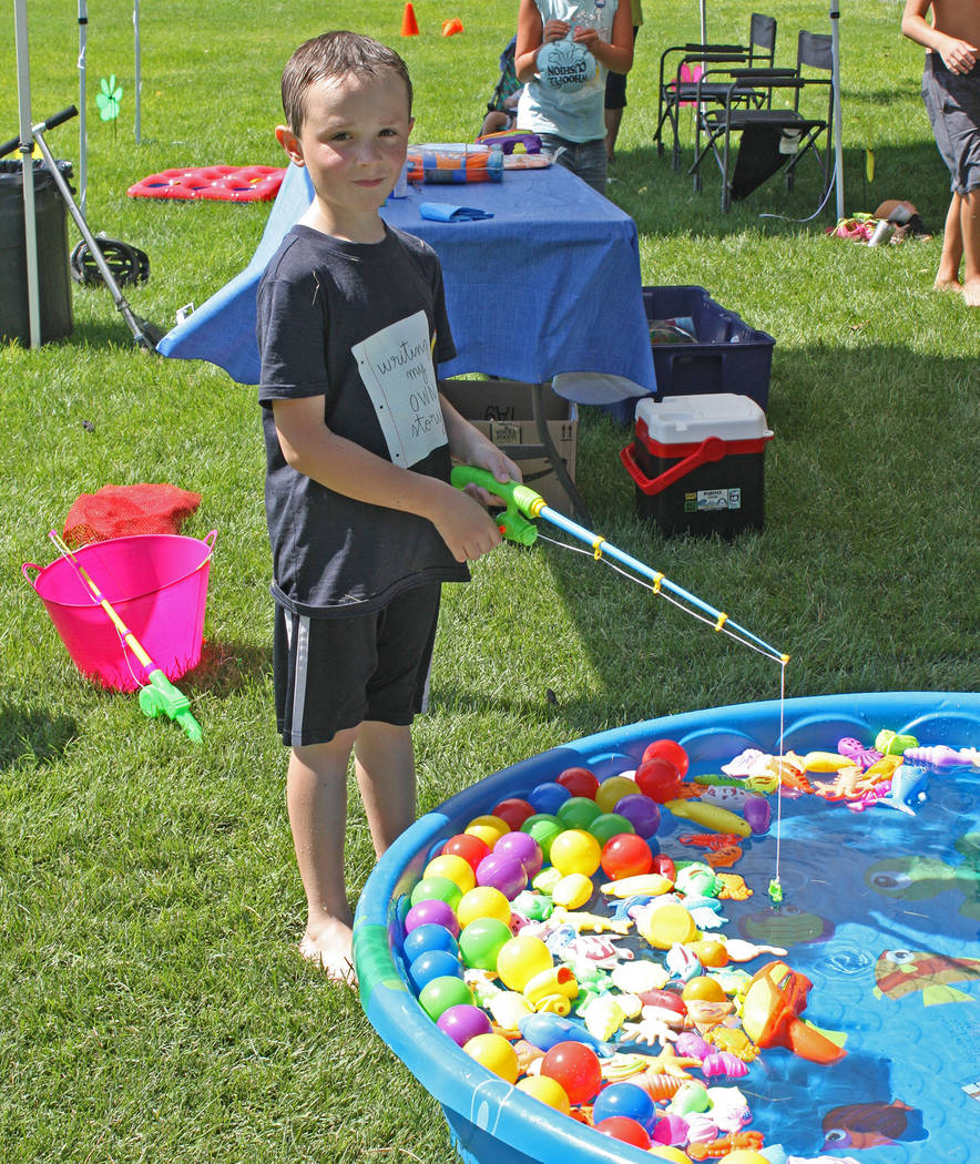 Robin Hebrock/Pahrump Valley Times A young Pioneer Celebration attendee smiles as he enjoys a f ...