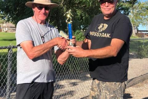 Tom Rysinski/Times-Bonanza & Goldfield News Tournament organizer Lathan Dilger, right, presents ...