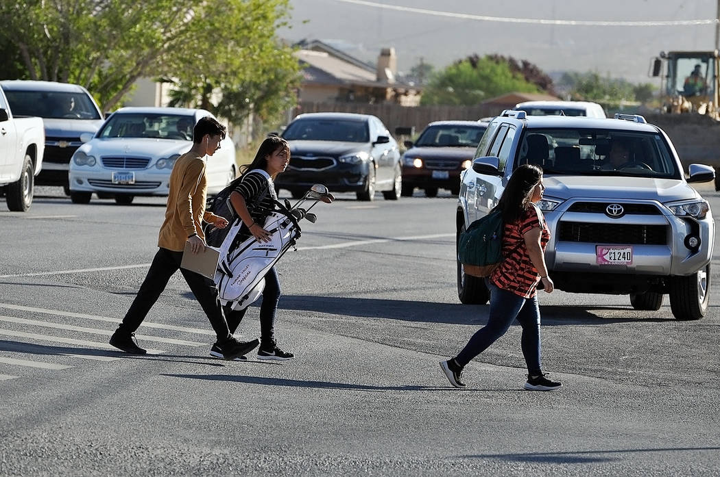 Horace Langford Jr./Pahrump Valley Times Young adults walk toward Pahrump Valley High School o ...