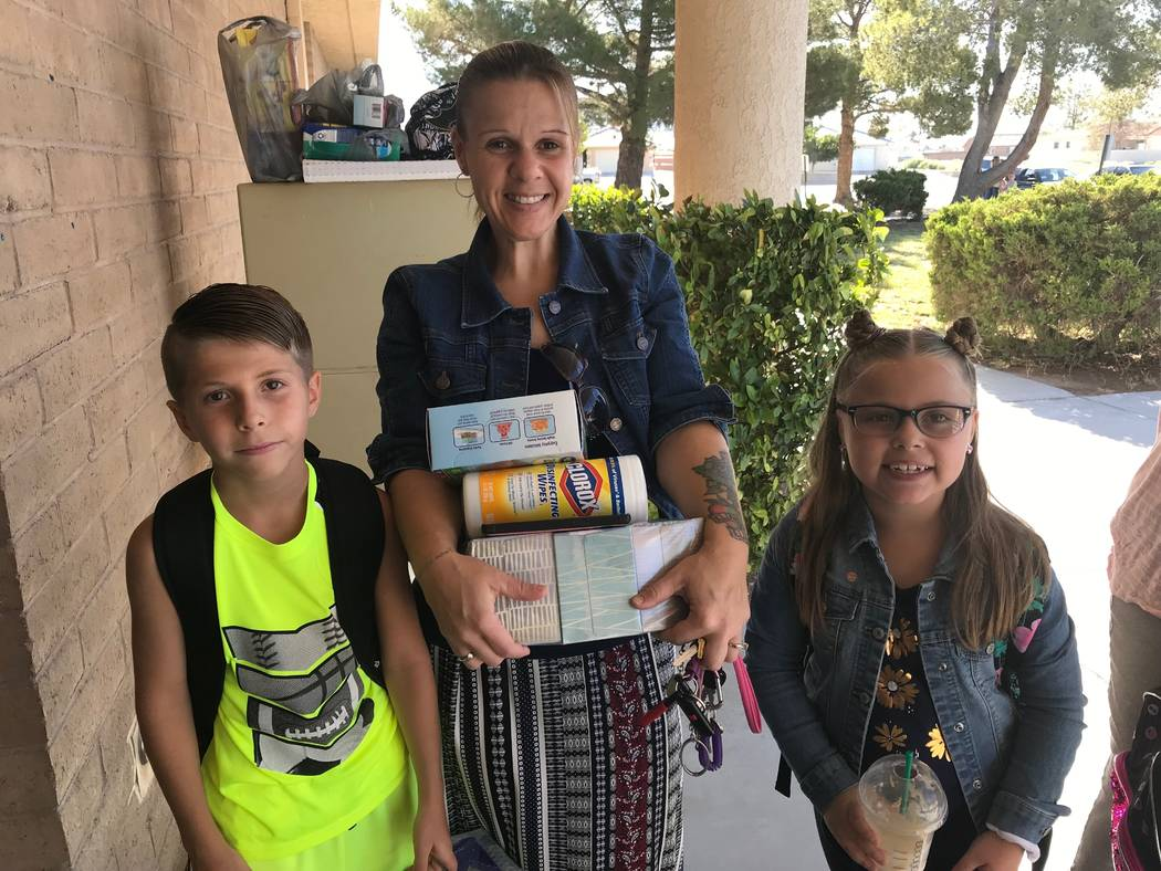 Jeffrey Meehan/Pahrump Valley Times Melissa Mevis (center) stands with her two children, Eli (l ...