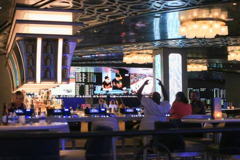 A newly renovated sports book can be seen from the a Taphouse bar at The STRAT hotel-casino in ...