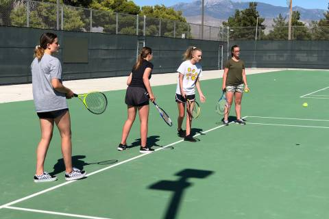 Tom Rysinski/Pahrump Valley Times The Pahrump Valley High School tennis team practices Tuesday ...