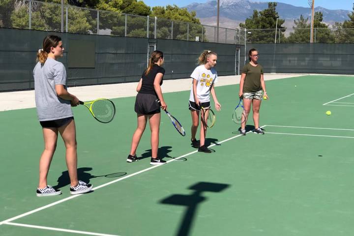 Tom Rysinski/Pahrump Valley Times The Pahrump Valley High School tennis team practices Tuesday ...