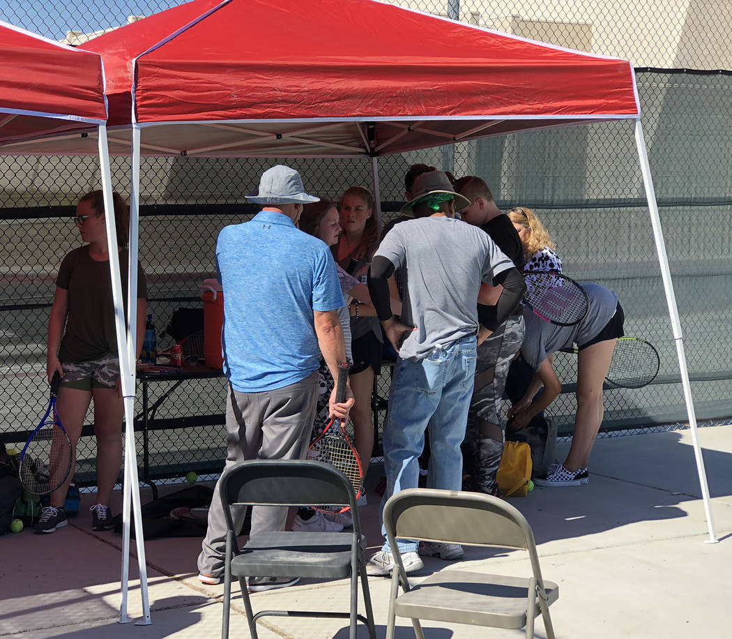 Tom Rysinski/Pahrump Valley Times Tennis players and coaches take a water break in the shade du ...