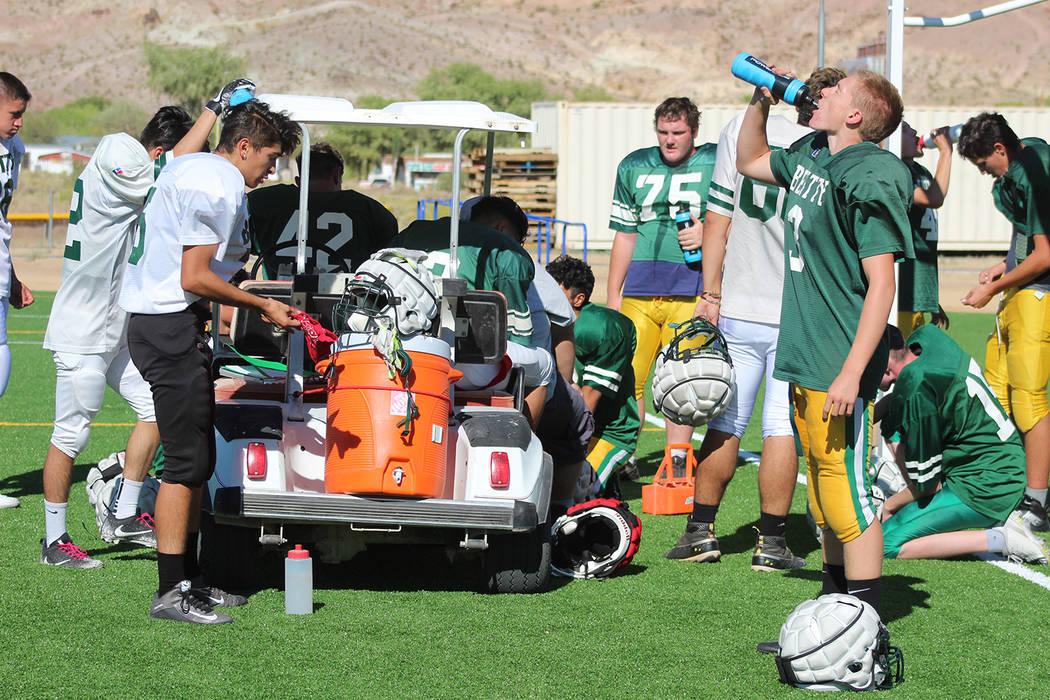 Tom Rysinski/Pahrump Valley Times Beatty High School football players take a water break during ...