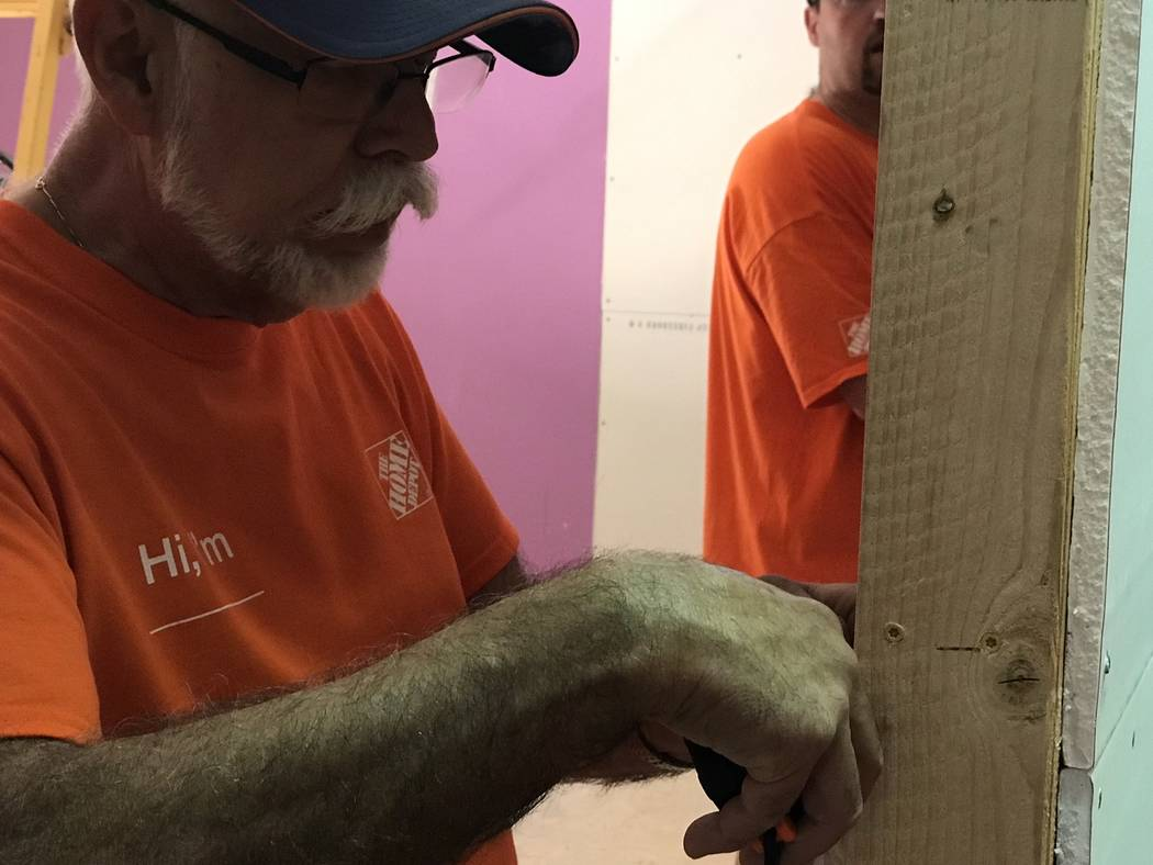 Jeffrey Meehan/Pahrump Valley Times Volunteers from Home Depot and the Nye County area assist i ...