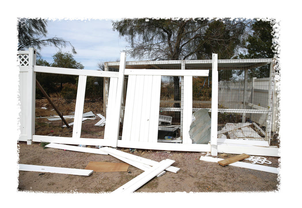 Broken fencing along the Northwest Academy property, owned by Marcel and Patricia Chappuis, the ...