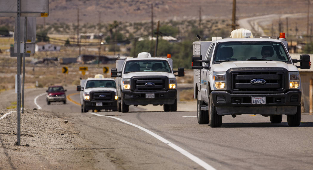 L.E. Baskow/Las Vegas Review-Journal Utility repair vehicles roll into Trona, Calif. last month ...