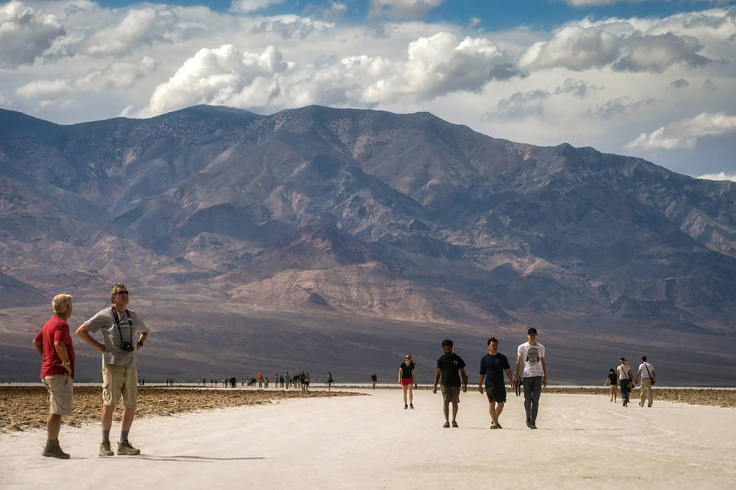 Photo courtesy of Kurt Moses Visitors explore the Badwater area of Death Valley National Park. ...