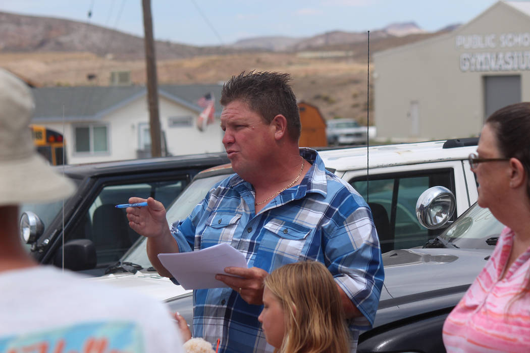 Jeffrey Meehan/Times-Bonnaza An auctioneer calls for bids on vehicles for the Esmeralda County ...