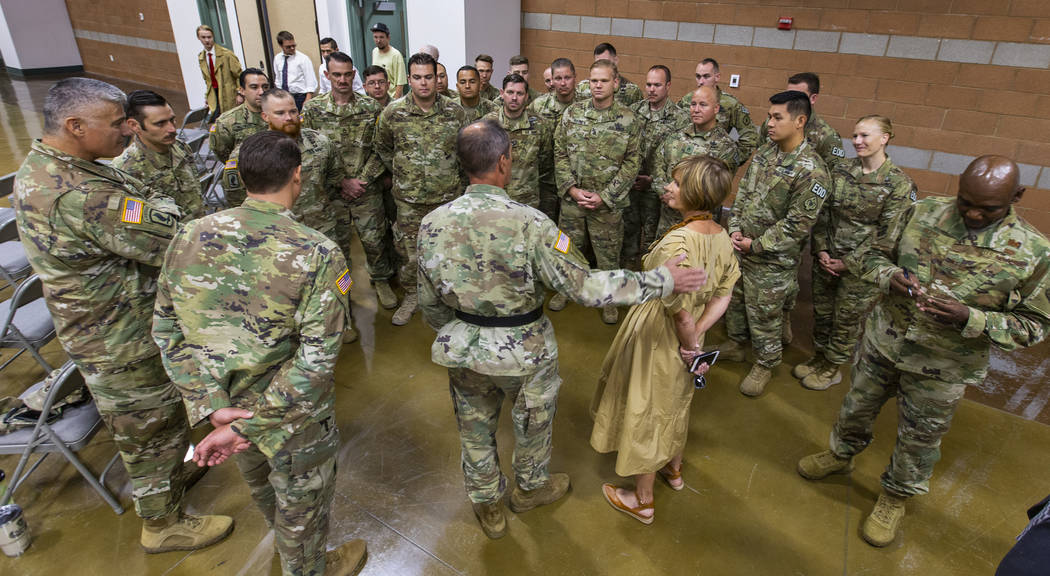 Brigadier General Zach Doser, center, chats with Rep. Susie Lee and soldiers with the Nevada Ar ...
