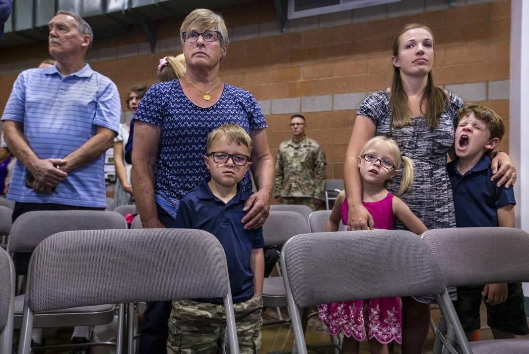 (From left) Kelle Brogan holds grandson Carrick Henry, 5, as his sister Karagan, 5, is held by ...