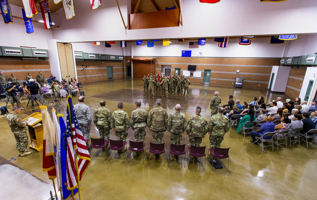 Soldiers with the Nevada Army Guard 3665th Explosive Ordnance Disposal Company are joined by fa ...