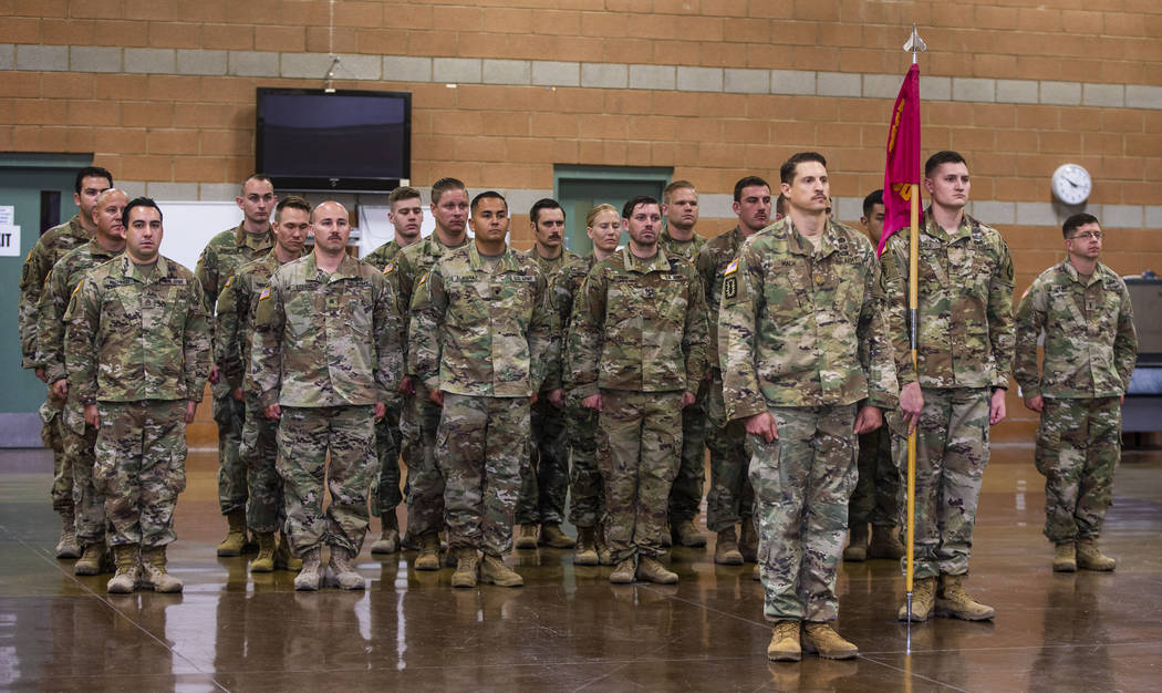 Soldiers with the Nevada Army Guard 3665th Explosive Ordnance Disposal Company stand at attenti ...