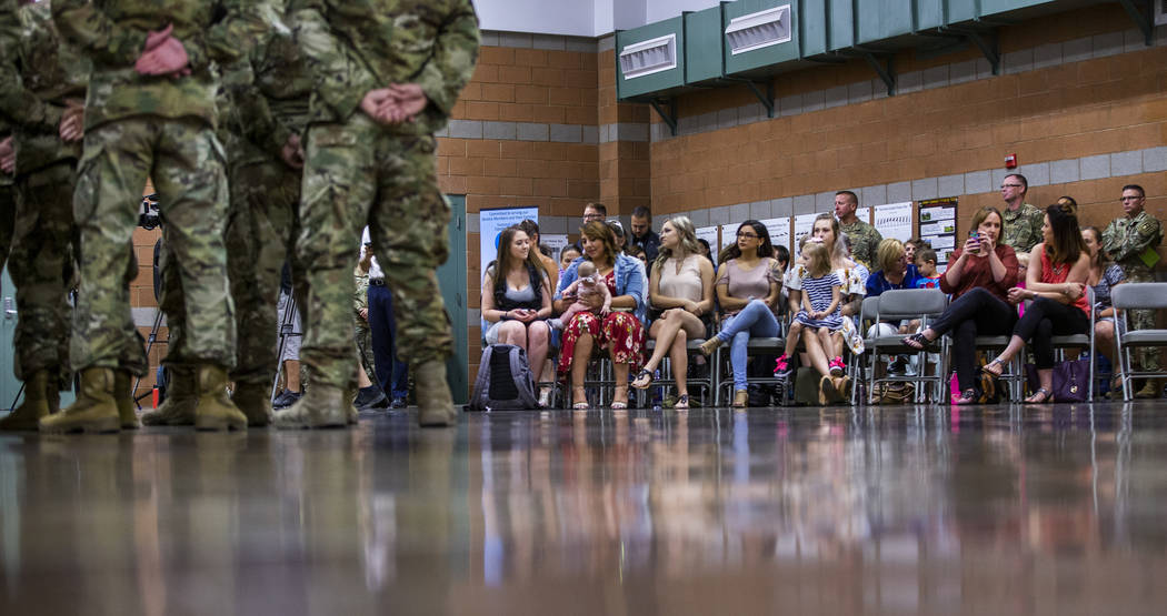 Families and friends look on as soldiers with the Nevada Army Guard 3665th Explosive Ordnance D ...