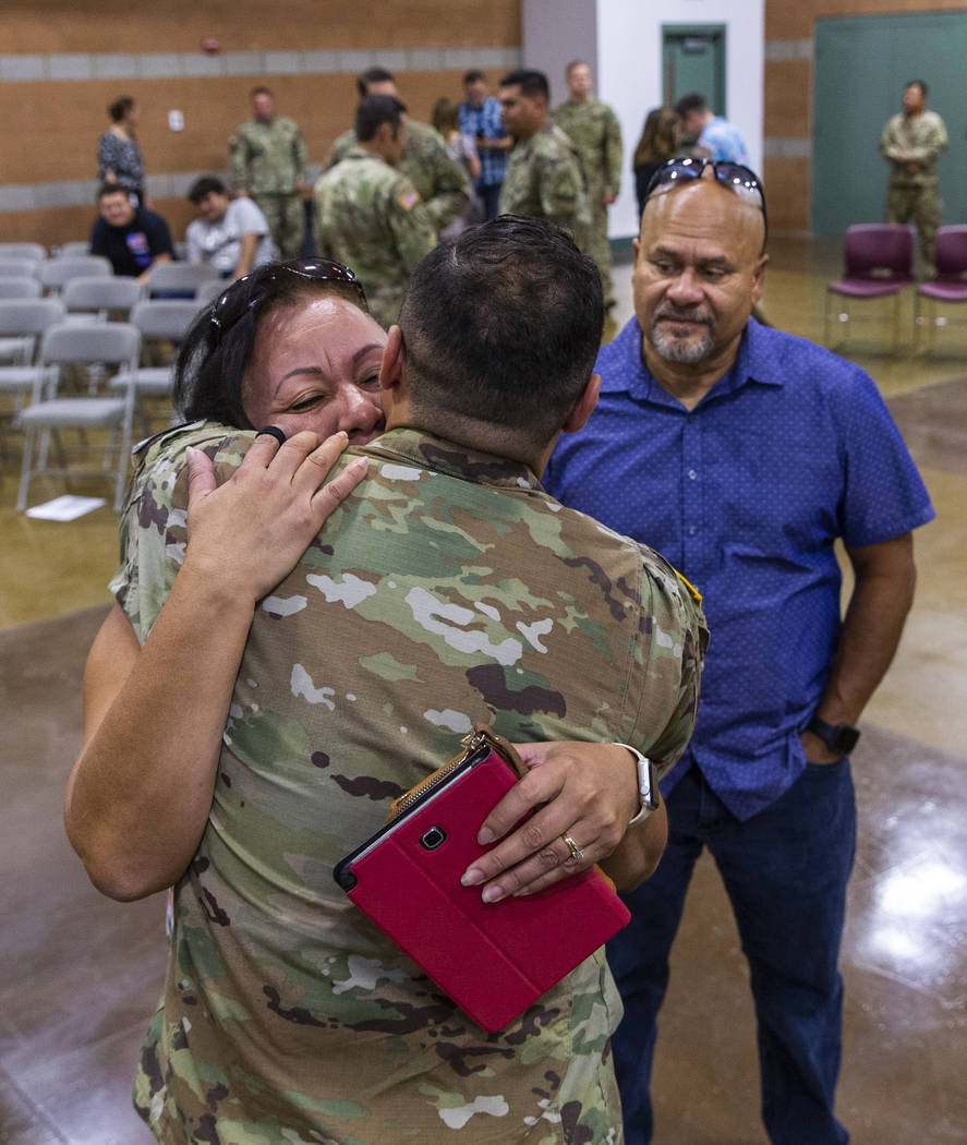 (From left) Maritza Pierluissi hugs her son Sgt. Ulises Pierluissi Jr. goodbye as his father Ul ...