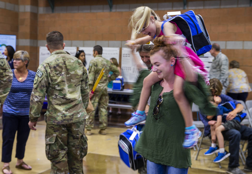 Shawna Henry spins around with Karagan Henry, 5, after a mobilization ceremony for her and othe ...