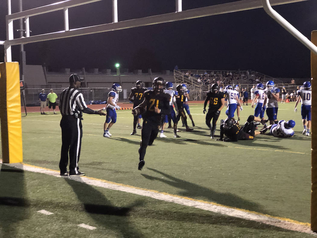 Tom Rysinski/Pahrump Valley Times Tony Margiotta scores one of his three touchdowns Friday nigh ...
