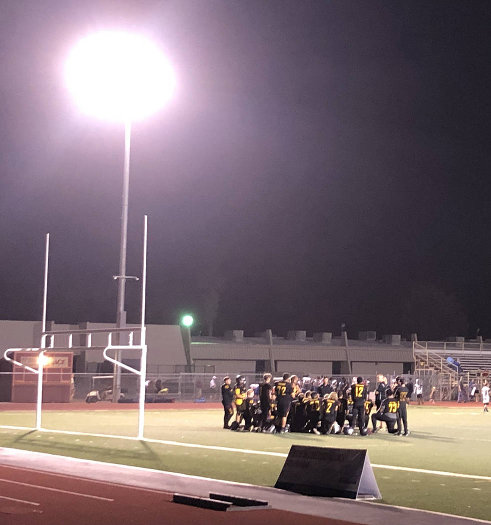 Tom Rysinski/Pahrump Valley Times Pahrump Valley High School football players gather with their ...