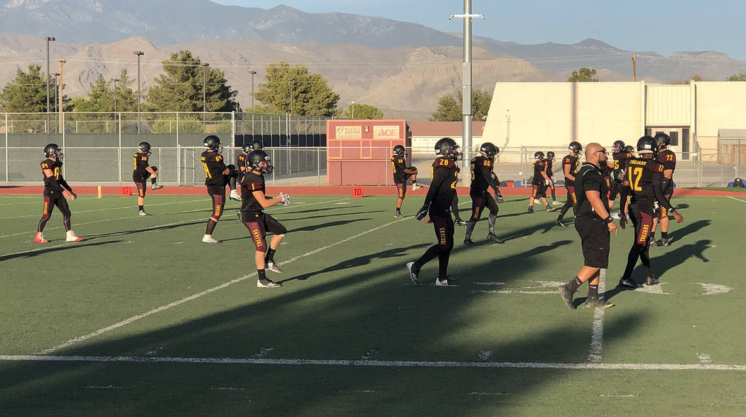 Tom Rysinski/Pahrump Valley Times Pahrump Valley High School football players stretch before Fr ...