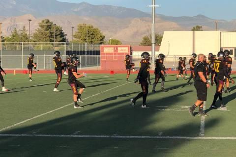 Tom Rysinski/Pahrump Valley Times Pahrump Valley High School football players stretch before Fr ...