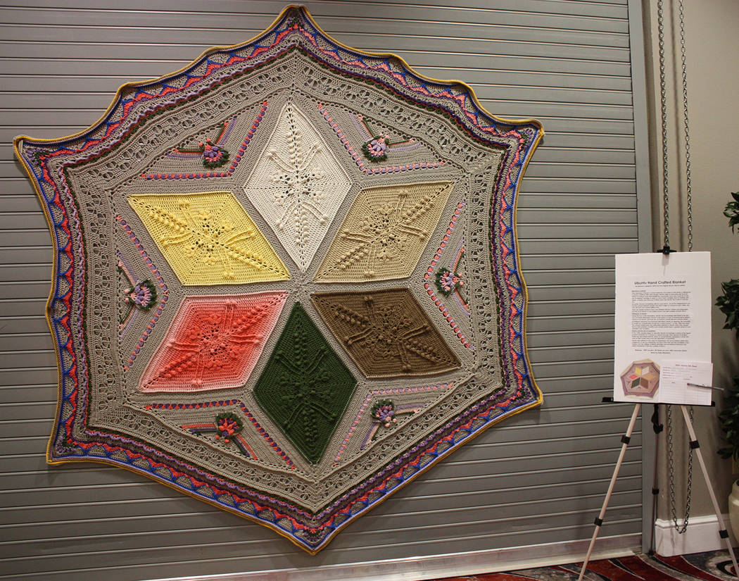 """Robin Hebrock/Pahrump Valley Times This """"Ubuntu"""" handcrafted blanket was made specially for the ..."""