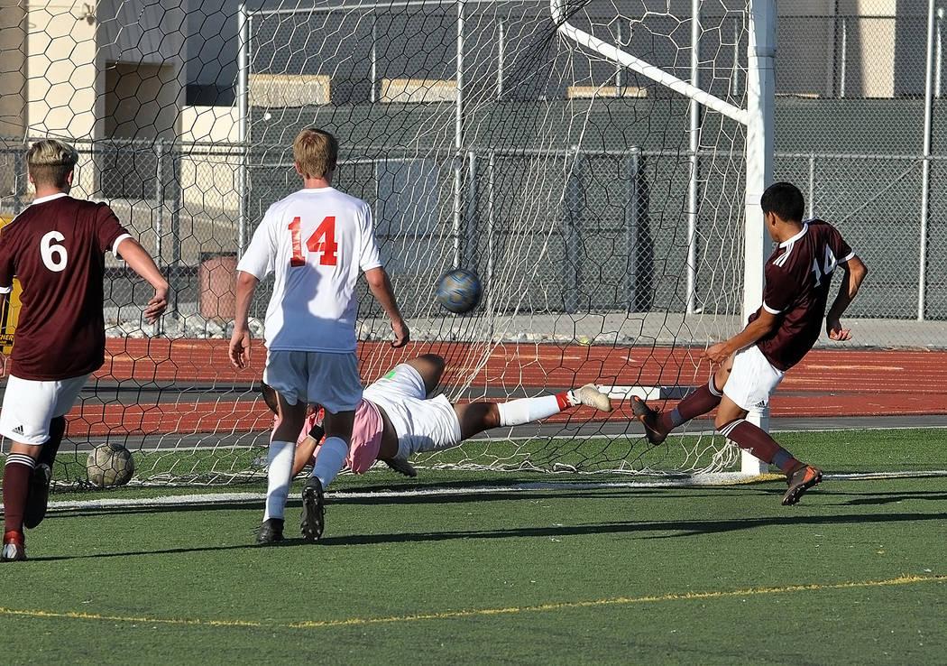 Horace Langford Jr./Pahrump Valley Times Senior Abraham Alvarez, right, scores the first goal o ...
