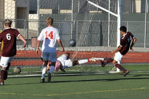Horace Langford Jr./Pahrump Valley Times Senior Abraham Alvarez, right, scores the first goal o ...