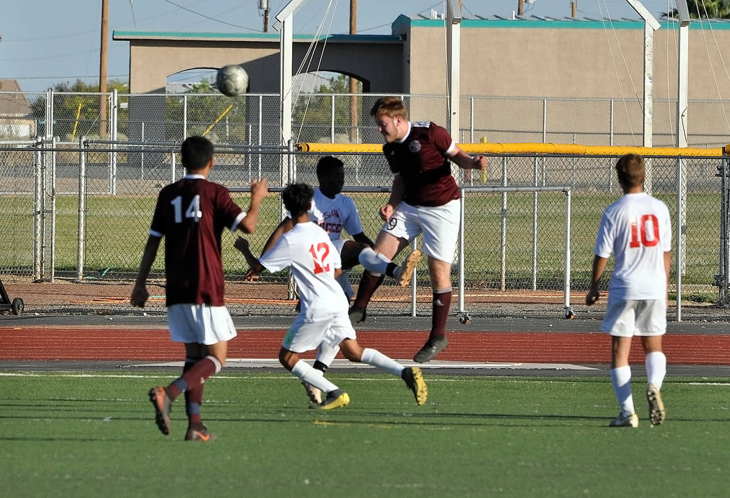 Horace Langford Jr./Pahrump Valley Times Pahrump Valley senior back Koby Lindberg heads the bal ...